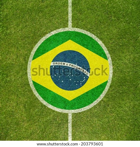 Football field center closeup with Brazilian flag in circle - stock photo