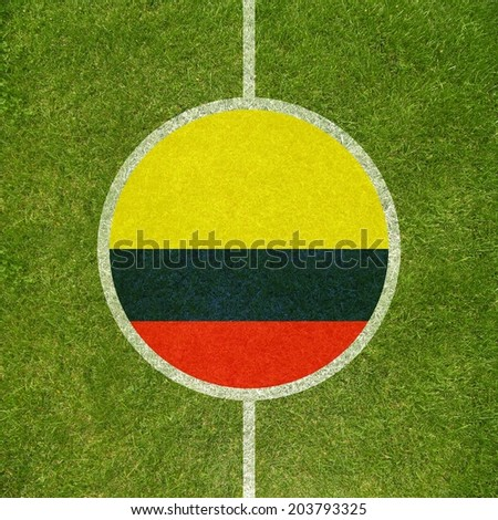 Football field center closeup with Colombian flag in circle  - stock photo