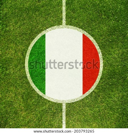 Football field center closeup with Italian flag in circle  - stock photo