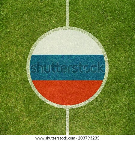 Football field center closeup with Russian flag in circle  - stock photo