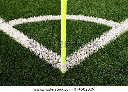 Football field corner detail with white marks and flag stick - stock photo