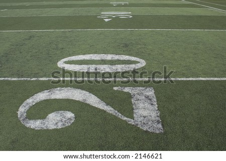 football field looking down the field from the 20 yard line. - stock photo
