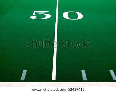 Football field with green turf and white yardlines and markers - stock photo