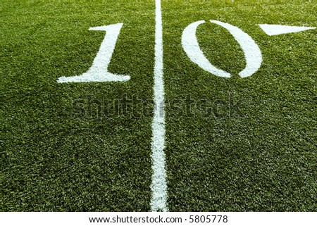 Football Field with 10 Yard Line splitting the frame - stock photo