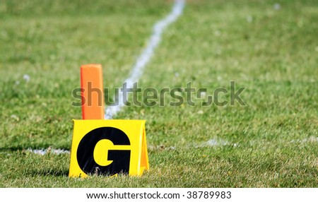 Football goal markers on a grass field. - stock photo