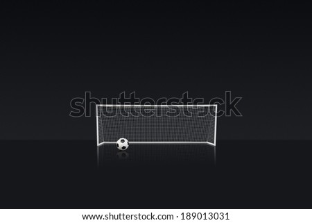 football goal with a black & white leather football in front - stock photo