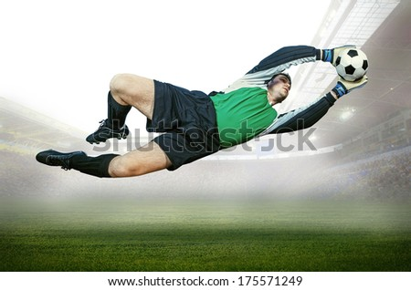 Football goalkeeper in action on field of stadium - stock photo
