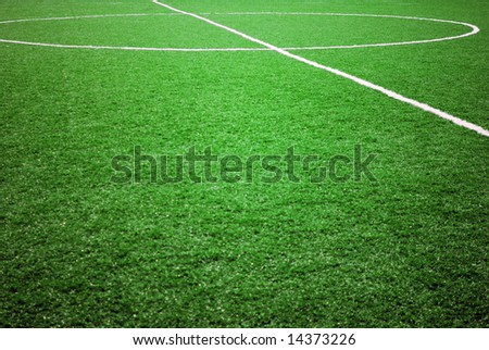 football grass background in light and shadow - stock photo