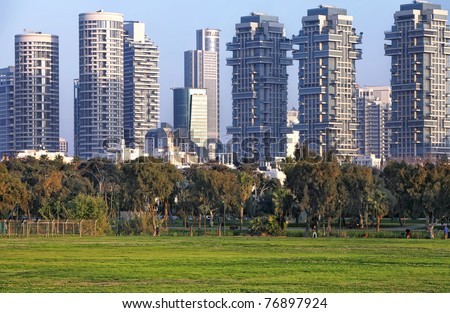 Football ground on the skyscrapers of Tel Aviv background (Israel) - stock photo