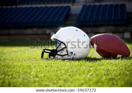 Football Helmet on a stadium field - stock photo