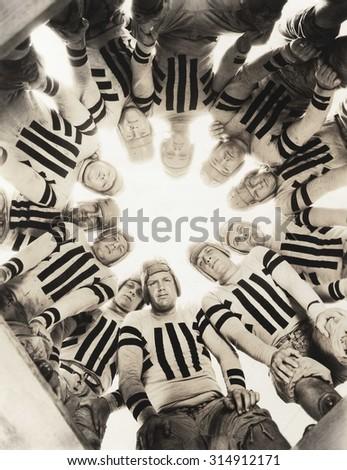 Football huddle - stock photo