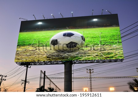 Football in the field advertising on billboard  - stock photo
