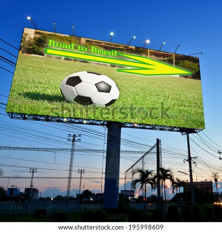 Football in the field advertising on billboard