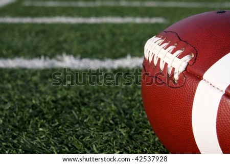 Football laces and yard lines beyond - stock photo