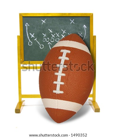 Football leaning against scoreboard - stock photo