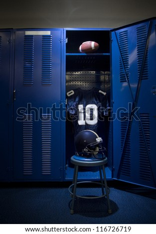 Football Locker in an empty locker room - stock photo
