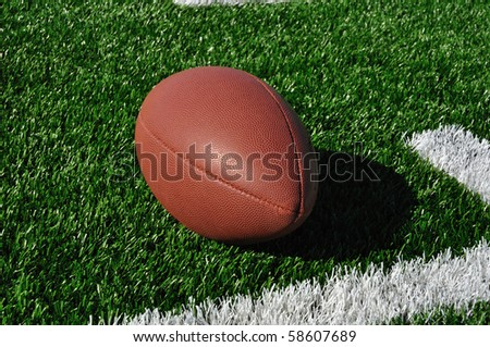 Football near Hash Marks on Artificial Turf - stock photo
