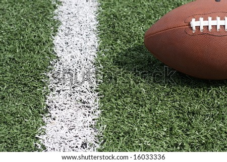 Football near the yard line - stock photo
