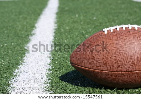 Football near the yardline with room for copy - stock photo