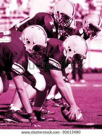 Football Offensive Lineman, pink hued - stock photo