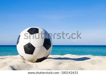 Football on a Beach - stock photo