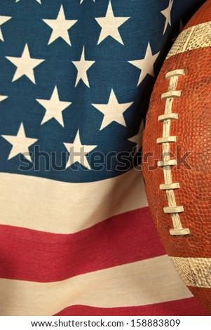 football on an American flag - stock photo