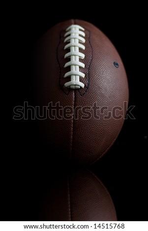 Football on black - stock photo