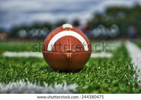 Football on Field near Sideline - stock photo