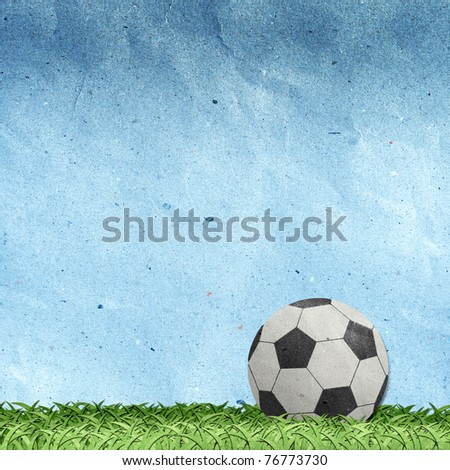 football on field recycled paper craft stick on paper background - stock photo