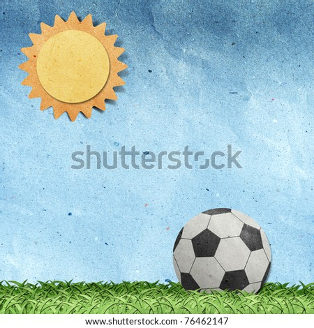 football on field recycled paper craft stick on white background - stock photo