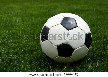 Football on grass - stock photo