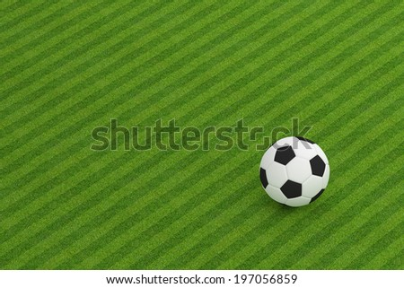 Football on grass field background - stock photo