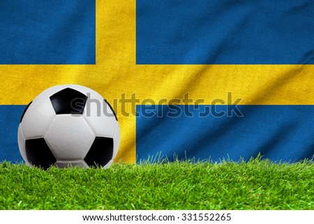 Football on grass field with wave flag of Sweden - stock photo