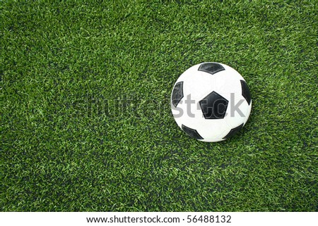 football on green grass - stock photo