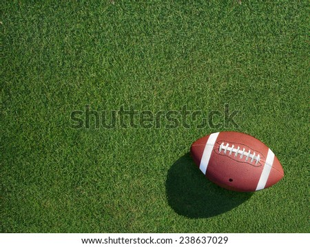 Football on green sports turf grass angled to the right.                                - stock photo