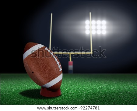 Football on tee ready to be kicked off - stock photo