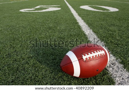 Football on the Field near the Fifty