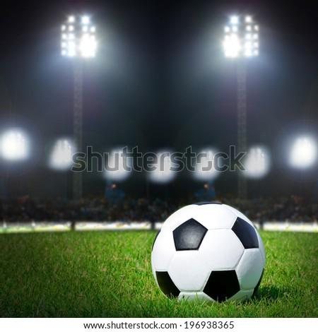 Football on the field with stadium light - stock photo
