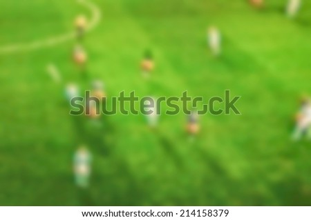 Football on tv blurred background - stock photo