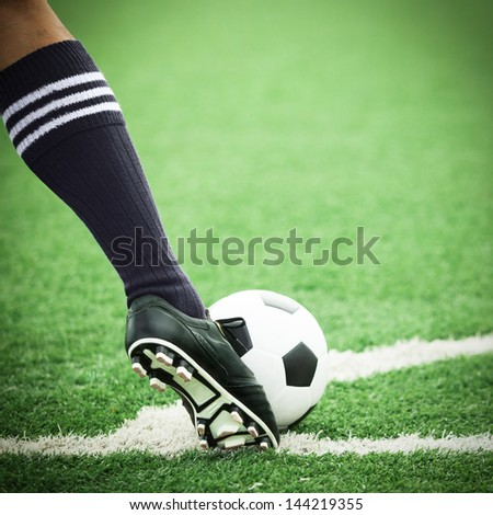Football or soccer ball at the kickoff of a game - stock photo