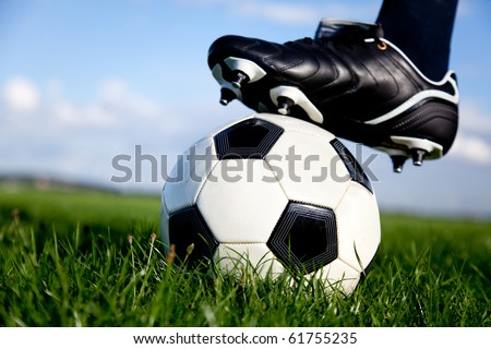 Football or soccer ball at the kickoff of a game - outdoors - stock photo