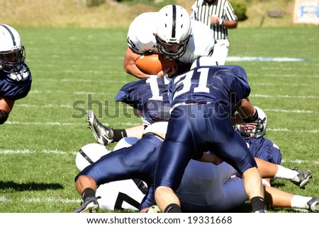 Football pile-up, logos removed - stock photo