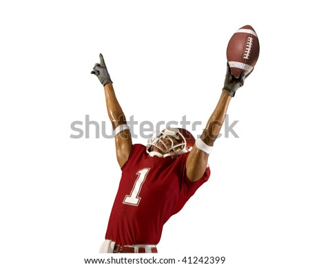 Football player celebrates wining touchdown - stock photo