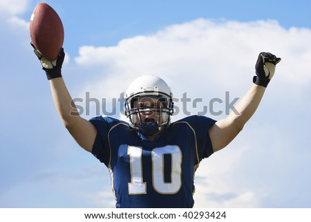 Football Player Celebrating a Touchdown - stock photo