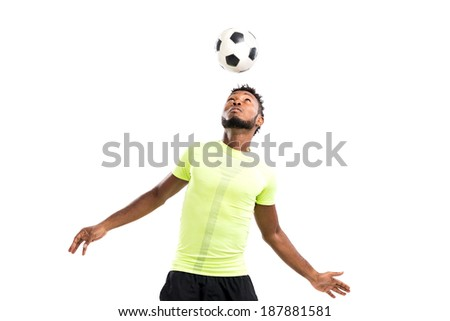 Football player hitting a ball with his head - stock photo