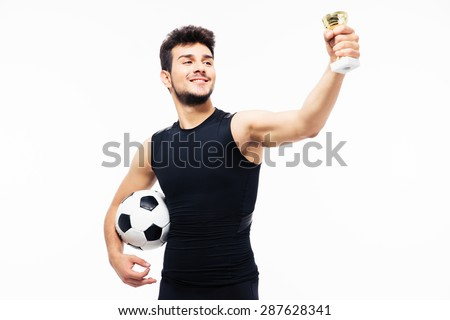 Football player holding winners cup isolated on a white background