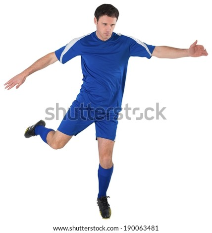 Football player in blue kicking on white background