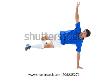 Football player in blue kicking on white background - stock photo