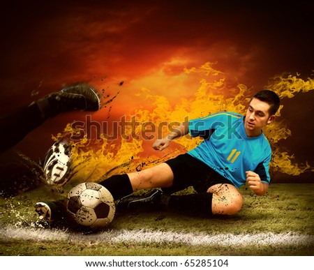 Football player in fires flame on the outdoors field - stock photo