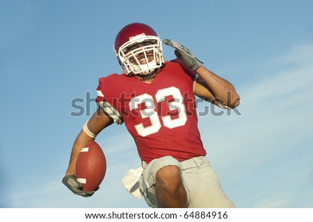 Football player in game action - stock photo